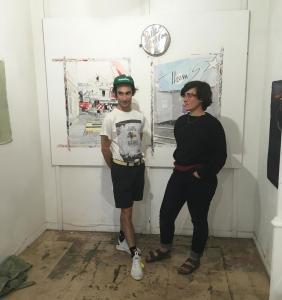 Camille Girard et Paul Brunet devant une partie de leurs œuvres réalisées en résidence